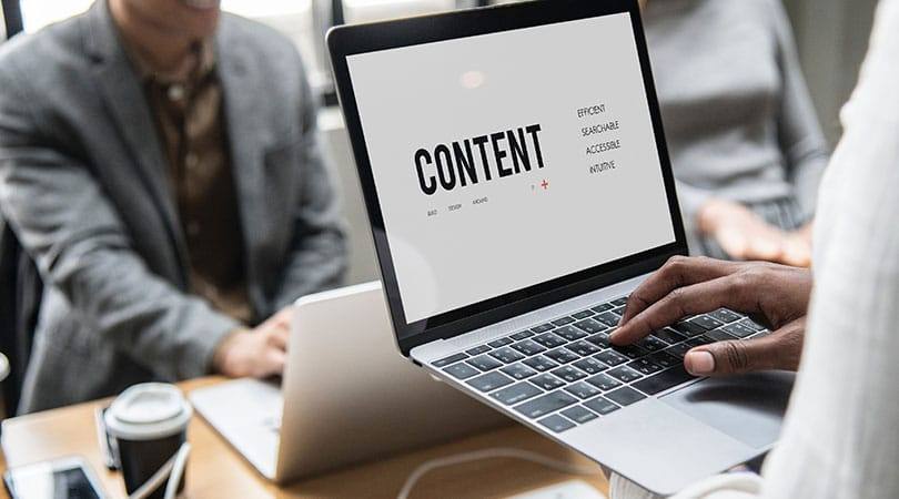 SEO for small businesses with content explained on laptop in woman arms